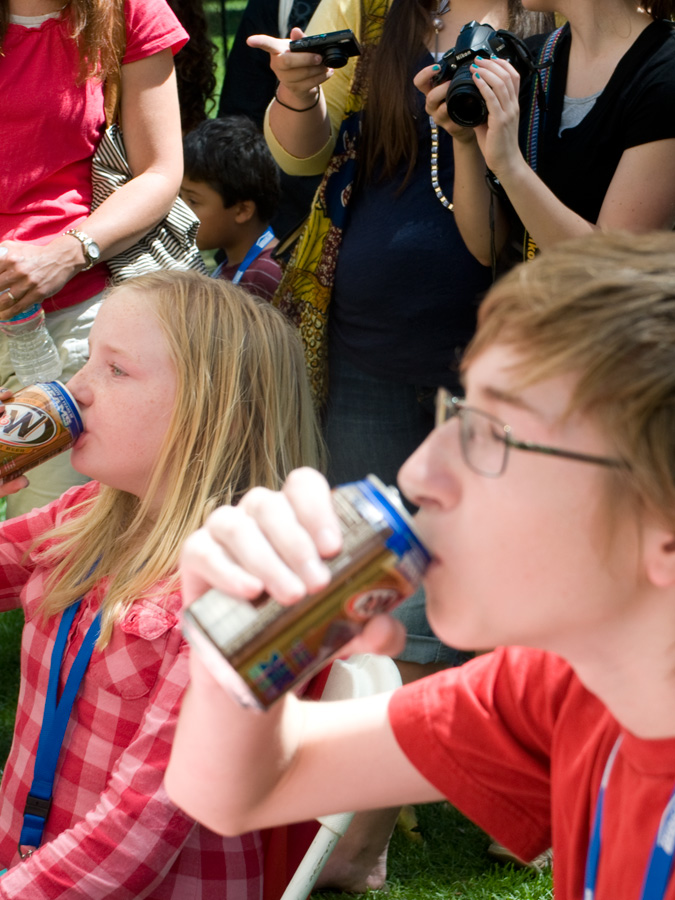 Zo and Kas taking part in Pioneer Days Root Beer Drinking contest. I am sure they had fun doing this.