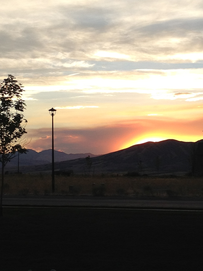 A sunset behind the mountains. We took this at a park right by the house. It looked better in person, sorry about the camera making it less spectacular.