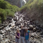 The kids standing at the base of the falls.