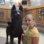 Zo posing by a Husky statue at Kas's new school