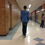 Kas strolling down the halls of the school.