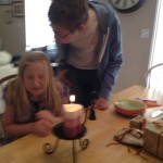 This is our new birthday candle.  :)  Kas got confused and tried to blow out Zo instead.
