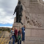 The kids and Elise standing at the monument of the Mormon Batallion