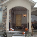 Shot of the front door as it is snowing. The Pumpkins are freezing, but they are pumpkins, right?