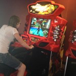 We were waiting for our movies to start so we went to the arcade to play, and Netter is riding a motorcycle