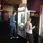 Kas and Zoba playing some at the arcade at the theatre place.