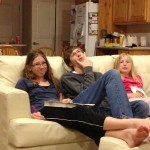 All the kids, sitting on the couch, relaxing in a cold Utah night