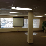The office was so plain, we needed a change of scenery, so we lowered the screen in the main room.