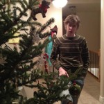 Kasmir is just chillin' while putting the ornaments on the tree