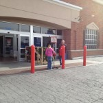 Zo giving some change to a Christmas charity outside