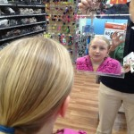 Looking at the results, in the mirror, Zo likes what she sees