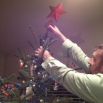 And after all the decorations (that we could find) the star gets placed on the tree