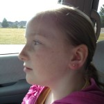 Ears successfully pierced, Zo is now trying to forget that they hurt.  What we do for beauty...