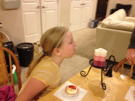 Blowing out the birthday candle, and I know she was wishing for her Daddy to get a brand new computer too