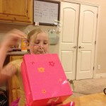Zo opening gifts on her 9th birthday.  My baby is growing up!  (that is from Elise, as my kids know they are not to grow up for me)