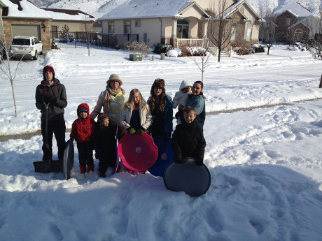 All the kids out with Elise and Natalie to sled