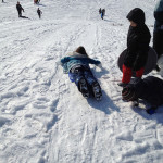 Going downhill on the sleds